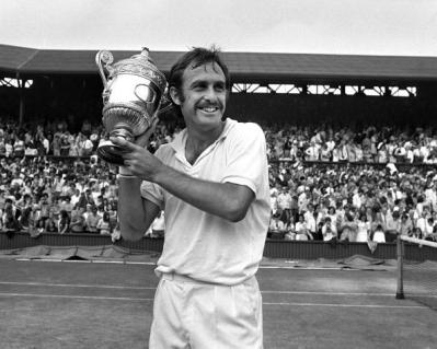 Sport, Tennis, All England Lawn Tennis Championships, Wimbledon, England, 3rd July 1971, Mens Singles Final, Defending Champion, Australia's John Newcombe, holds the trophy aloft after winning the tournament by beating USA's Stan Smith 6-3, 5-7, 2-6, 6-4,